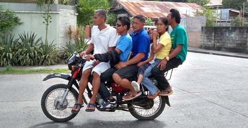Some creative Filipinos showing you don't need a van to fit your entire family.